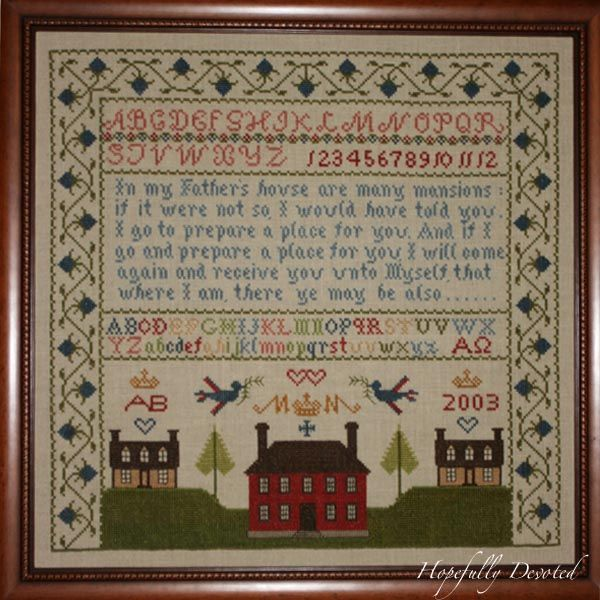 cross stitch of mother baking cookies